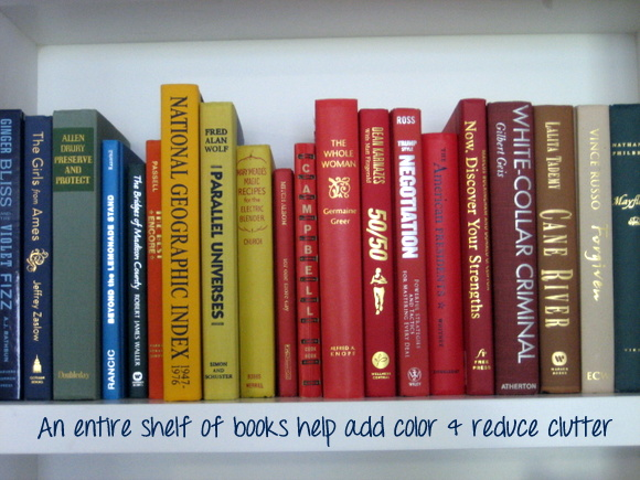 If you are working with a large bookshelf or built-ins, create one or two shelves that are all books.