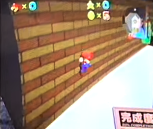Mario falling off an early version of Whomp's Fortress.
