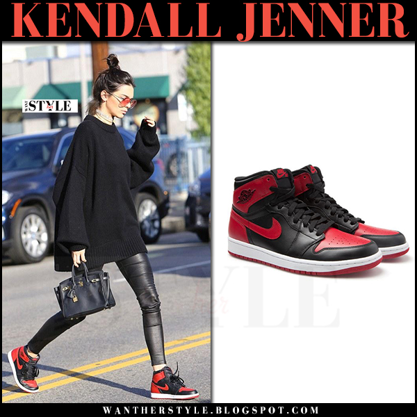 Kendall Jenner in black sweater, black leggings j brand edita and red and black Nike sneakers what she wore
