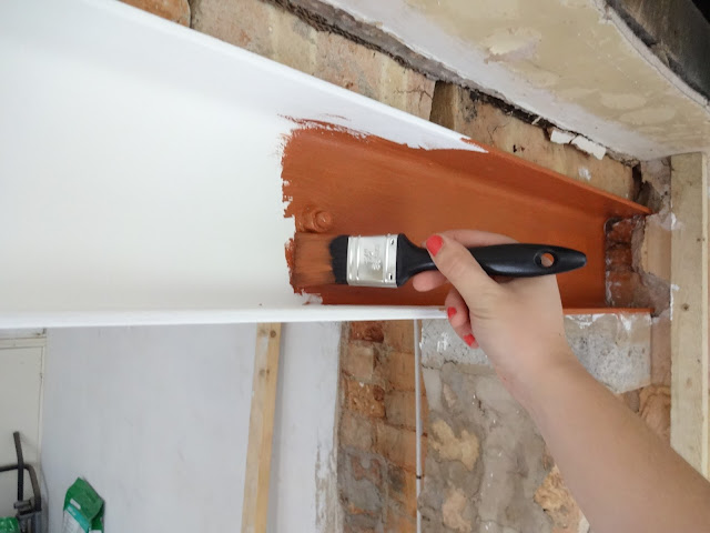 painting a steel beam