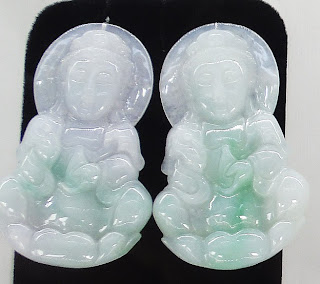 white jade Buddha pendants with carvings