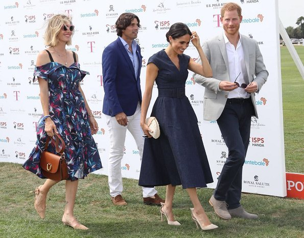 Meghan Markle wore Carolina Herrera dress, Aquazzura 'Deneuve pumps, Birks Bee Chic blue topaz earrings, Tom Ford sunglasses, carries J Crew clutch