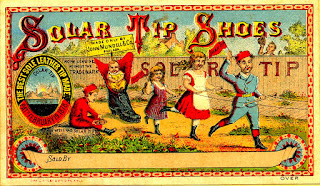 Children parade advertising Solar Tip Shoes with company trademark. Reds and blues predominate.