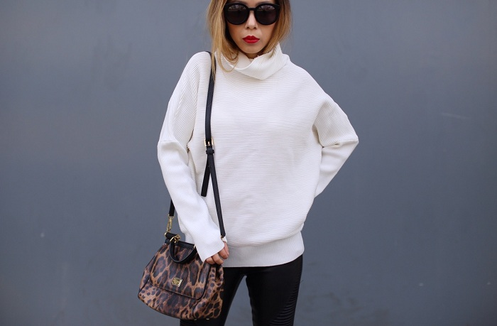 Shein turtleneck pullover, dolce and gabbana sisly leopard bag, blank denim moto pants, cat footwear wedge booties, karen walker super duper sunglasses, nyc street style