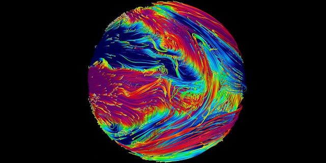 This image shows magnetic field lines in the atmosphere of a hot giant exoplanet. Time snapshot of magnetic field lines in the numerical simulation of a hot giant exoplanet atmosphere (a model of HD209458 b, but with a temperature structure similar to HAT-P-7 b). Magnetic field lines are color-coded to represent the azimuthal (toroidal) magnetic field, with blue representing a negative-directed field (saturated at − 50 G) and magenta representing a positive-directed field (saturated at 50 G), with green and yellow ranging from − 5 to 5 G, respectively. The vantage point is looking onto the east-side terminator. Credit: PSI