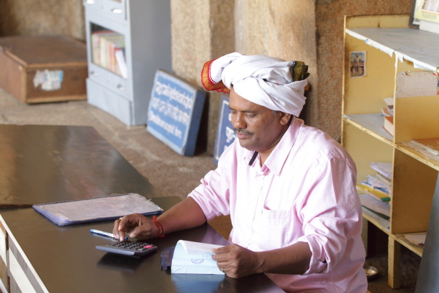 Accountant busy at work - Shravanabelagola Baahubali temple, Karnataka