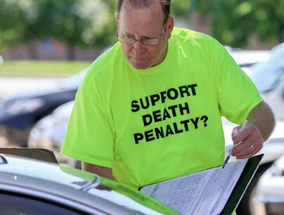 Gathering signatures against the repeal of the Nebraska death penalty.