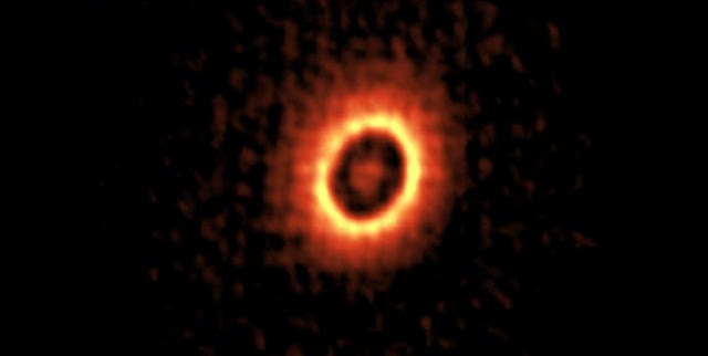 ALMA image of the dusty disk around the young star DM Tau. You can see two concentric rings where planets may be forming.