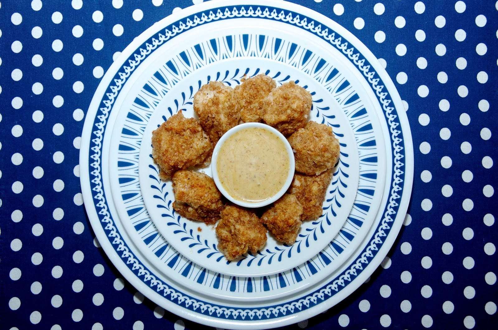 Chicken nuggets on Corelle blue and white plates with a Butlers polka dot placemat