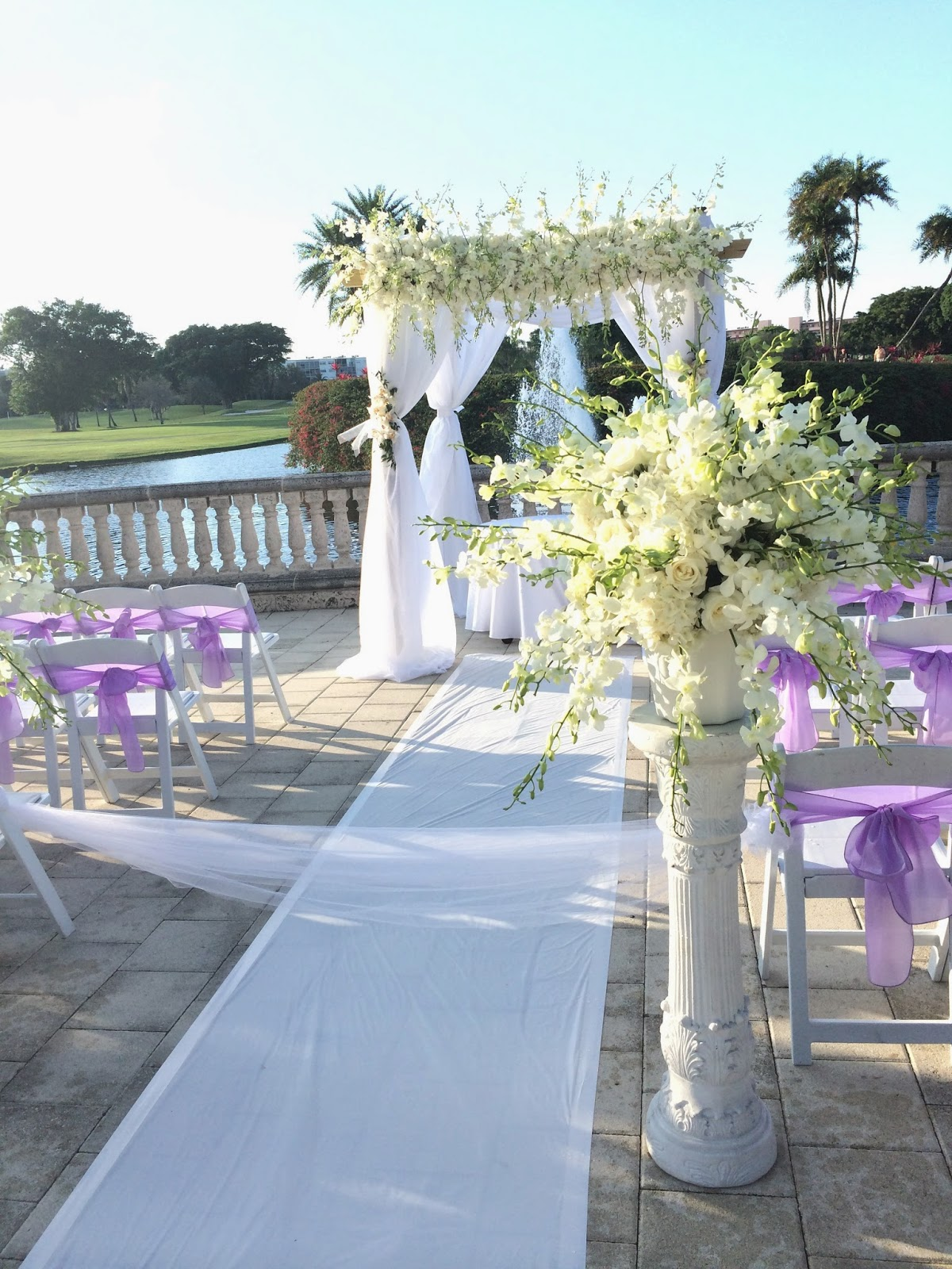 Wedding ceremony gazebo with flowers and white drape