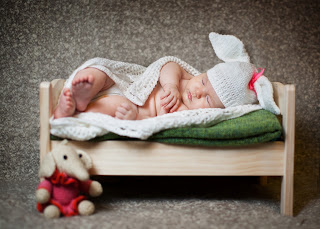 baby_sleeping_in_little_miniature_bed_photography_image_for_social_sharing.jpg
