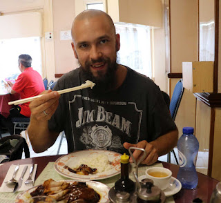 Eating Chinese food with chop-sticks