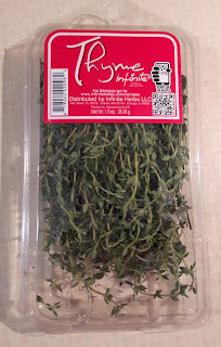 Fresh thyme, harvested, washed and sold in plastic packages.
