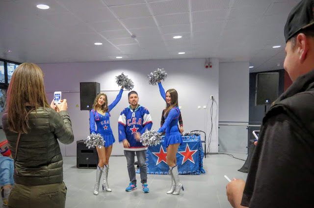 St. Petersburg SKA cheerleaders with a fan