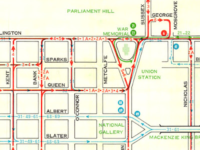 Section of a 1962 Ottawa transit map showing downtown routes where those going east on Wellington onward toward Rideau must detour down to Queen St via O'Connor to go around Confederation Square, because Wellington is one-way westbound around Confederation Square.