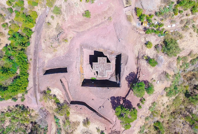 drone shot of Saint George's Church in Lalibela (shaped as a giant cross), which is carved 15 metres into the ground