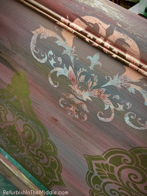 headboard with medallion stencils and shades of pink chalk paint and accents of gold paint
