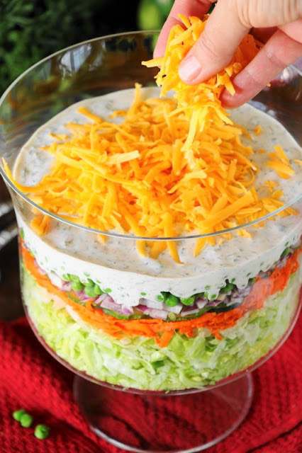 Making Layered Salad for a crowd.