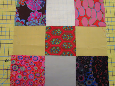 9-patch with improvisational use of fabric placement - marty mason