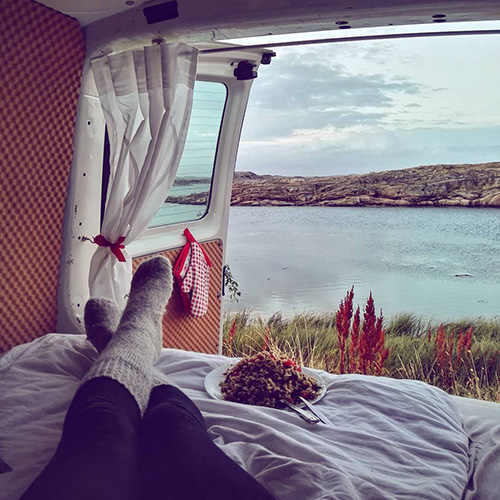 Dinner in a van with a view on the sea