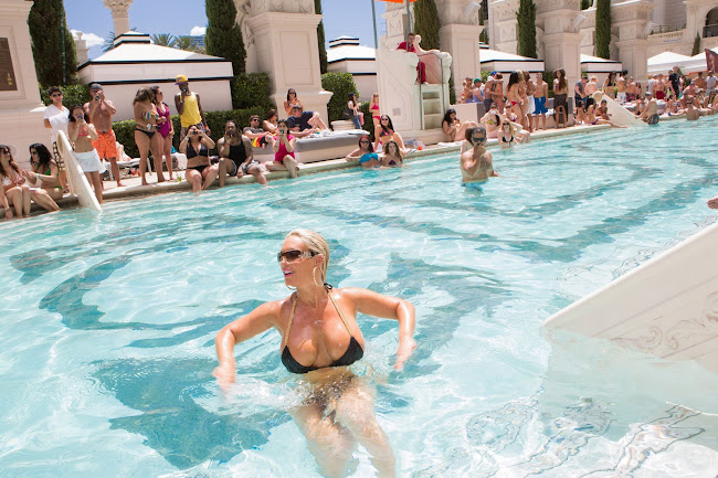 Nicole Coco Austin goes for a dip in a pool in Vegas