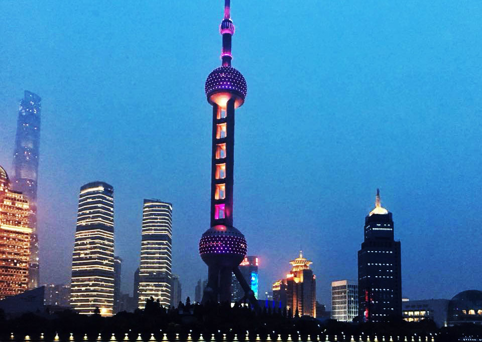 Shanghai skyline at dusk featuring oriental pearl tv tower