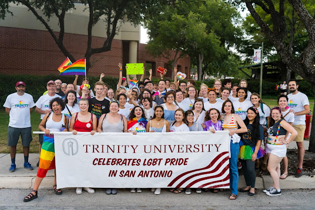 Tigers holding up their parade banner at the San Antonio PRIDE Parade
