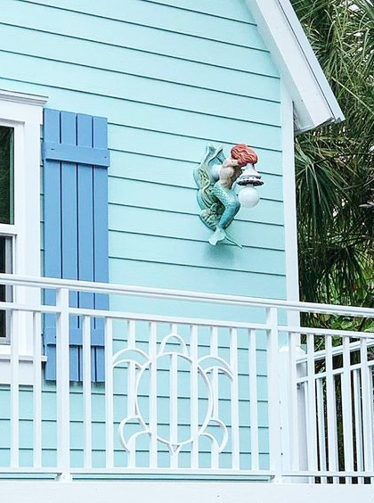 Blue Painted Beach Cottage Exterior Curb Appeal with Unique Wall Decor