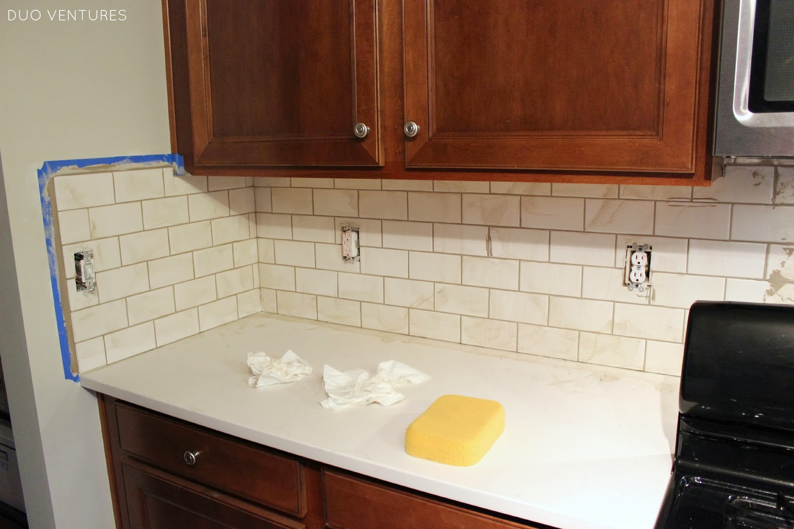 Duo Ventures: Kitchen Update: Grouting & Caulking Subway