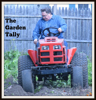 Husband plowing up the garden Vickie's Kitchen and Garden