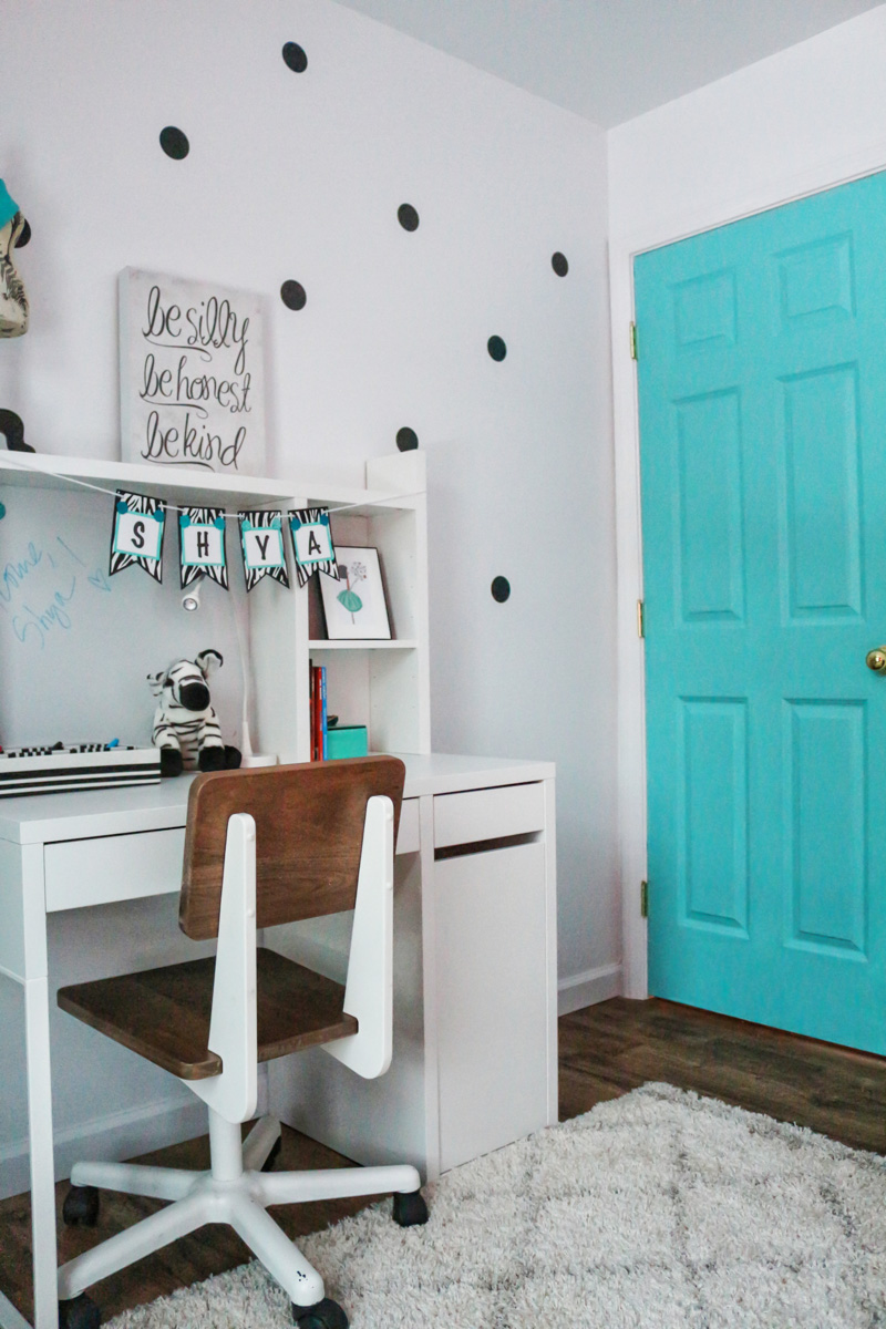turquoise painted door in girls room
