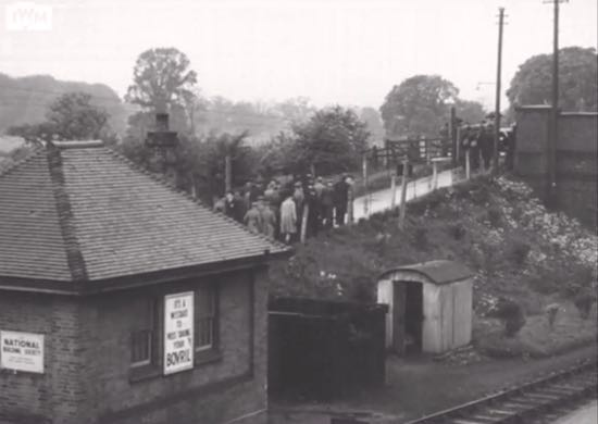 "The British and Russian entourage leaving Brookmans Park station on 21 May, 1942 Image at 3'38"" in video below Screen grab courtesy of the Imperial War Museum"