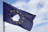 Damaged EU Flag (Photograph Credit: Christopher Furlong | Getty) Click to Enlarge.