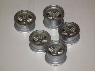 re-coated Tamiya POrsche 910 wheels to dull them down.