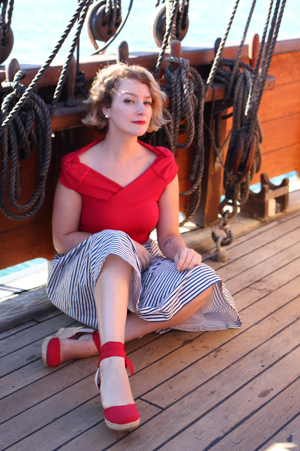 @findingfemme wears review Australia red knit top with Review striped skirt and lace up red wedges on the tall ship Enterprize.