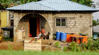 Locals sitting outside their houses in Bioko