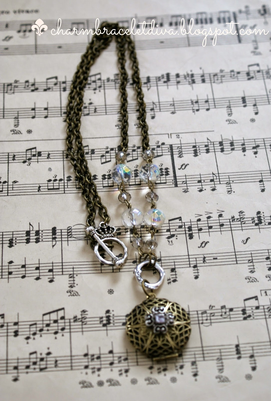 filigree antique brass locket with repurposed charm necklace