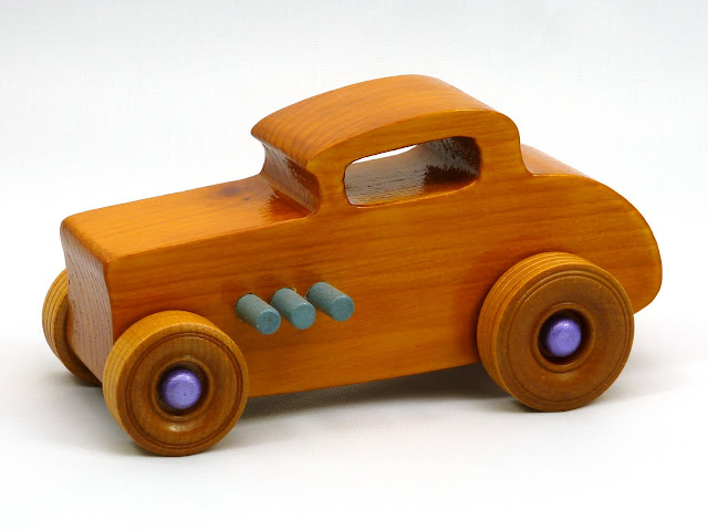 Left Side Front - Wooden Toy Car - Hot Rod Freaky Ford - 32 Deuce Coupe - Pine - Amber Shellac - Metallic Purple Hubs - Gray Exhaust