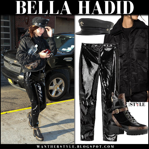Bella Hadid in black bomber jacket, black patent pants and black platform boots louis vuitton laureate street style december 11
