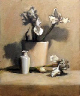 Oil painting of white plastic irises in a creme-coloured vase with a white porcelain vase and more plastic irises in the foreground.