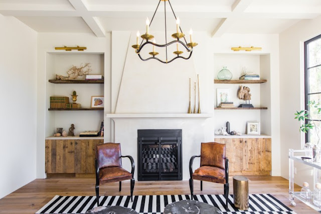 Beautiful living room in villa with European inspired interiors by Leigh Herzig - seen on Hello Lovely
