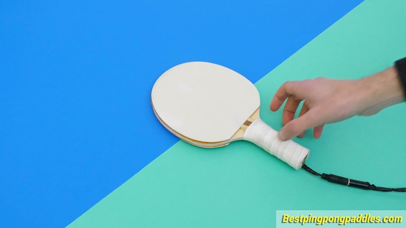 ping-pong-paddles-in-hand.jpg