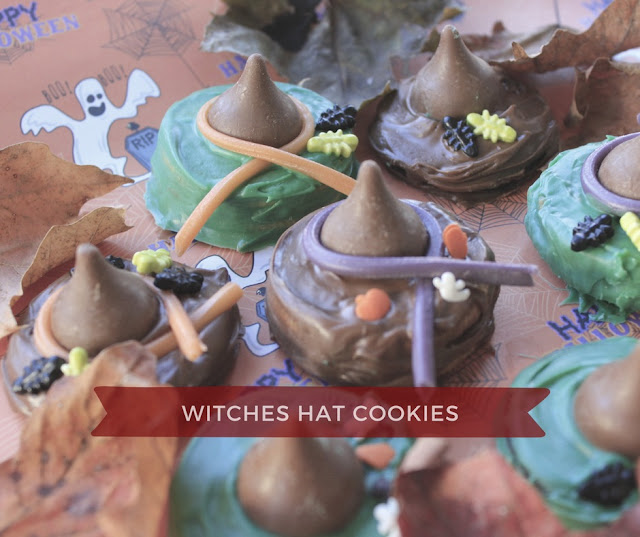 Fill the Cookie Jar with Easy Witches Cookies made with oreo cookies and hershey kisses.