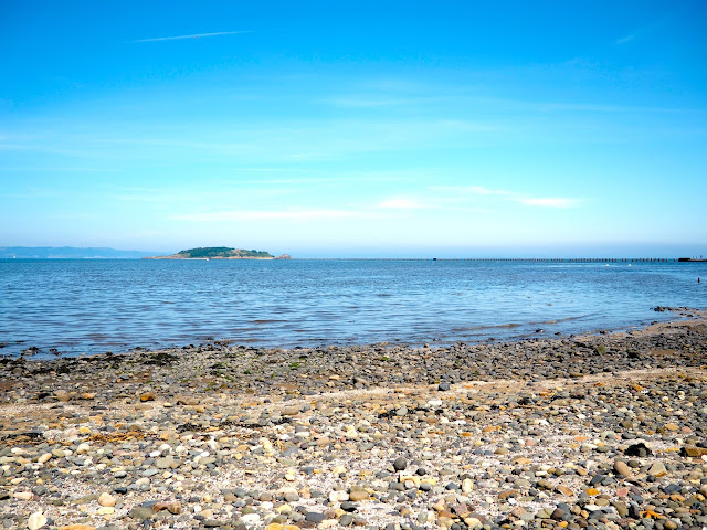 View out to Cramond Island and Firth of Forth from Dalmeny Estate Shore Walk in north Edinburgh