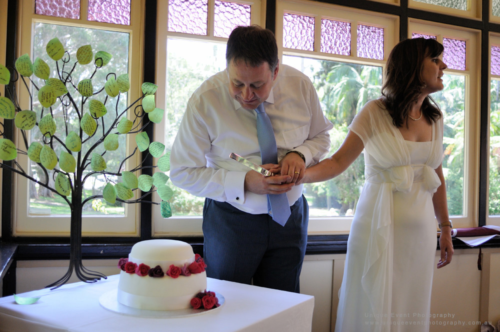 Preparing to cut the cake, Garden Wedding Photographer Sydney by Kent Johnson.