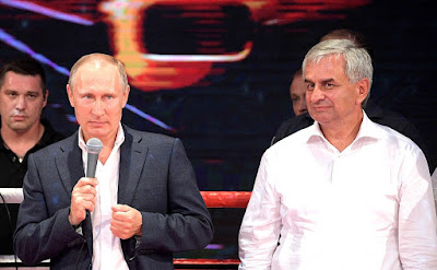 Vladimir Putin attending the Platform S-70 8th International Professional Combat Sambo Tournament of League S-70. With President of Abkhazia Raul Khadjimba.