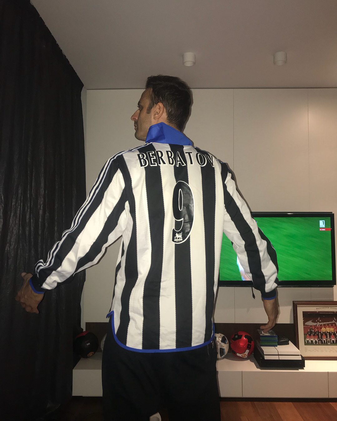 Dimitar Berbatov and his most prized possession - a Newcastle shirt with Alan Shearer's number on the back