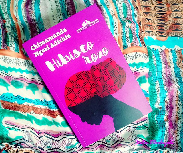 A imagem exibe o livro Hibisco Roxo em fundo colorido.