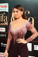 Hansika Motwani in Glittering Deep Neck Transparent Leg Split Purple Gown at IIFA Utsavam Awards 014.JPG
