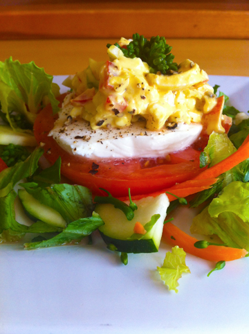 Egg Salad tomato rounds with mozzarella greens and veggies
